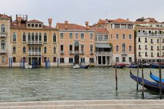 Canal in Venice with docked gondola and boats, Royalty Free Stock Photography