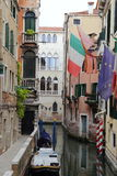 Canal in Venice with docked gondola and boats, Stock Images