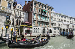 A canal in Venice/gondolas on the blue waters. Royalty Free Stock Photography