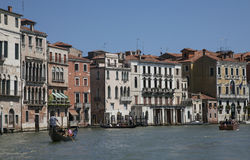 A canal in Venice/gondolas on the blue waters Stock Photos