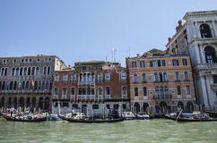 A canal in Venice/gondolas and colorful surroundings. Stock Photos