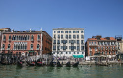A canal in Venice, Italy/blue waters, gondolas and historic buildings. Stock Photo