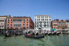 A canal in Venice, Italy/ blue waters and gondolas. Royalty Free Stock Image