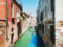 Canal in Venice, Italy. Brick wall Royalty Free Stock Images
