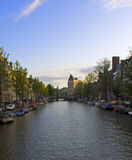 Canal view in Amsterdam, Netherlands. Canal and boats in Amsterdam, Netherlands Stock Photo