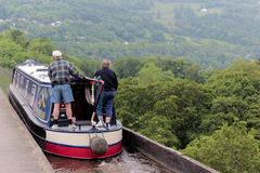 Canal in Wales. Retired couple on a narrow boat in Wales. The canal is by llangollen and they are crossing Pontcysyllte aqueduct Royalty Free Stock Photography