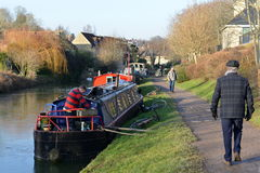 Canal Walkway. Bradford on Avon, UK - January 21, 2017: People enjoy a sunny winter day on the Kennet and Avon Canal in rural Wiltshire. The canal is a popular Stock Images