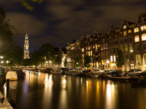 Canal With Westerkerk In Amsterdam At Night Stock Image
