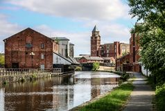 The Canal at Wigan Pier. The view along the canal towards Wigan town centre Royalty Free Stock Photography
