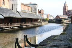 The Canal in Wigan Town Centre. The view along the canal past Wigan Pier in the centre of the town Stock Photos