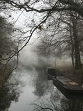Canal with working boat viewed from bridge Stock Photos
