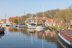 Canal with yachts and traditional houses in Enkhuizen, The Netherlands Royalty Free Stock Photos