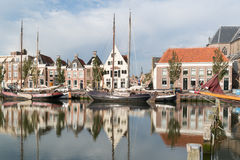 Canal Zuiderhaven in Harlingen, Friesland, Netherlands. Old houses on quay of Zuiderhaven harbor canal with boats in Harlingen, Friesland, Netherlands Stock Image