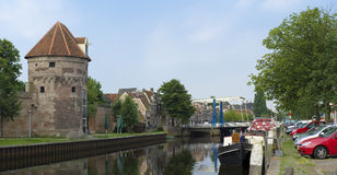 Canal in Zwolle, Netherlands. View on an ancient castle wall with tower in zwolle, netherlands stock image