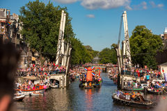 Canalboat with a orange dutch windmill. On the Nieuwe Herengracht with a open Walter Süskindbridge op the Canalparade 2016 royalty free stock photography