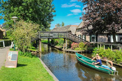 Canalboat with toutists in Giethoorn Royalty Free Stock Photo