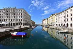Canale Grande in the historical downtown of Trieste, Italy. Canale Grande with many boats in the city quarter Borgo Teresiano as seen from the Ponte Rosso royalty free stock photos