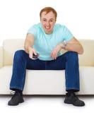 Canali televisivi maschii dell'interruttore nella disperazione Fotografia Stock