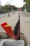 Canalizações flexíveis na estrada Foto de Stock
