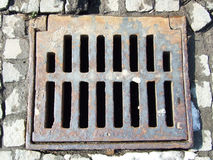 Rectangular sewer. On the road in Bucharest, Romania Stock Images
