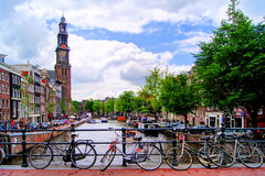 Canals of Amsterdam. Bicycles lining a bridge over the canals of Amsterdam, The Netherlands Stock Photo