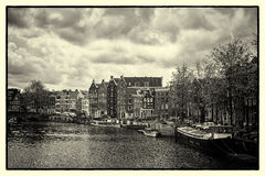 Canals of Amsterdam. Amsterdam is the capital and most populous. City of the Netherlands. B&W photo Stock Photos