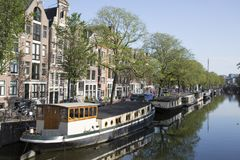 Amsterdam, canal and houseboats Royalty Free Stock Images