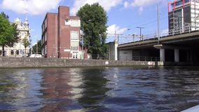 Through the canals of Amsterdam. Hundreds of kilometers of canals, more than 1,500 bridges and about 90 islands allowed Amsterdam to receive the title of ` stock footage