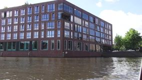 Through the canals of Amsterdam. Hundreds of kilometers of canals, more than 1,500 bridges and about 90 islands allowed Amsterdam to receive the title of ` stock video
