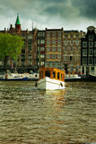 Canals of Amsterdam, Netherlands. Houses and boats on Amsterdam canals, Netherlands. HDR Stock Photography
