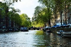 Canals in Amsterdam, Netherlands, Europe and colorful buildings stock photos