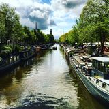 Canals of Amsterdam Netherlands. Exploring the canals and boats of Amsterdam Stock Images