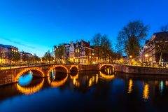 Canals of Amsterdam at night. Amsterdam is the capital and most populous city of the Netherlands.  stock photo