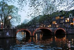Canals of Amsterdam by night. Canals in Amsterdam at night. The Nederlands Stock Photography