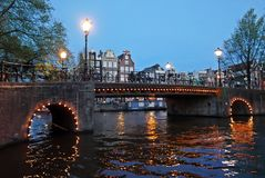Canals of Amsterdam by night. Canals in Amsterdam at night. The Nederlands Royalty Free Stock Photo