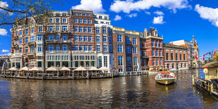 Canals of Amsterdam.Panoramic image. Beautiful Amsterdam canals in sunny weather royalty free stock photography