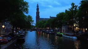 The Canals of Amsterdam typical view by night  City of Amsterdam. The Canals of Amsterdam typical view by night  Amsterdam Netherlands videoclip stock video footage