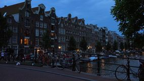 The Canals of Amsterdam typical view by night  City of Amsterdam. The Canals of Amsterdam typical view by night  Amsterdam Netherlands videoclip stock video
