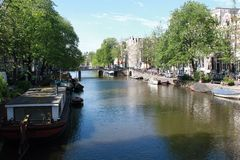 The canals of Amsterdam. Walking along the canals of Amsterdam stock photo
