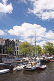 Canals of Amsterdam on warm summer day Stock Images