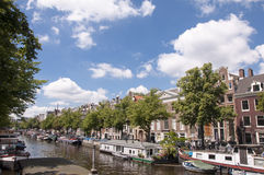 Canals of Amsterdam on warm summer day Stock Photo