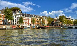Canals and boats of Amsterdam. Holland royalty free stock images