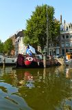 Canals and boats of Amsterdam royalty free stock images