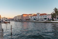 Canals of the city aveiro in colorful sunset Portugal stock photography