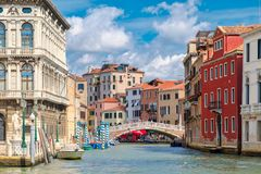 Canals and colorful old palaces in Venice. On a beautiful summer day Stock Photos