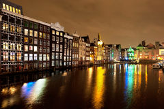 Canals with lights on water in Amsterdam at night Royalty Free Stock Image