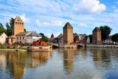 Canals and medieval towers, Strasbourg, France. Medieval towers along the beautiful canals of Strasbourg with reflections, France Royalty Free Stock Photography