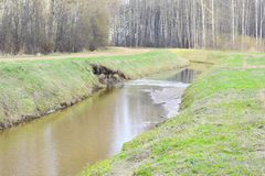Water canal washed away the road. Canals, or navigations, are human-made channels, or artificial waterways, for water conveyance, or to service water transport royalty free stock image