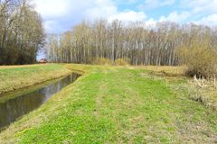Water canal green grass forest country house. Canals, or navigations, are human-made channels, or artificial waterways, for water conveyance, or to service water stock images