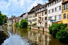 Canals of Strasbourg France with reflections. Picturesque houses lining the canals of Strasbourg, France, with reflections Stock Photography